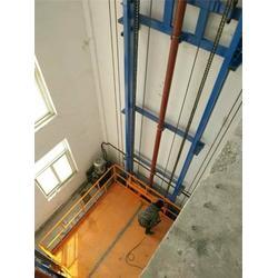 鸡西升降机-泉峰升降机(在线咨询)剪刀式升降机图片