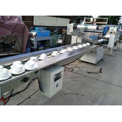 消毒餐具包装机-兴溢机械设备(在线咨询)餐具包装机图片