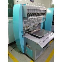 硅胶滴胶机 服装硅胶商标点胶机 服装矽利康点胶设备图片