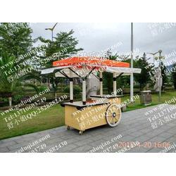 景区木制饰品售卖车,移动户外花车图片