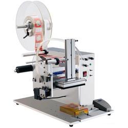 直线贴标机价钱、腾卓机械(在线咨询)、大连直线贴标机图片